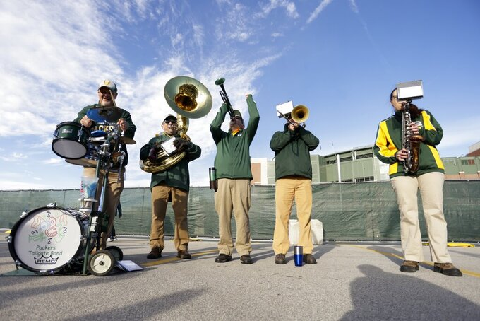 Fans outside Lambeau Field before an NFL football game between the Green Bay Packers and the Washington Football Team Sunday, Oct. 24, 2021, in Green Bay, Wis. (AP Photo/Matt Ludtke)