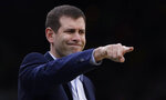 Boston Celtics coach Brad Stevens points to his players during the first quarter of an NBA basketball game against the Charlotte Hornets in Boston, Wednesday, Jan. 30, 2019. (AP Photo/Charles Krupa)