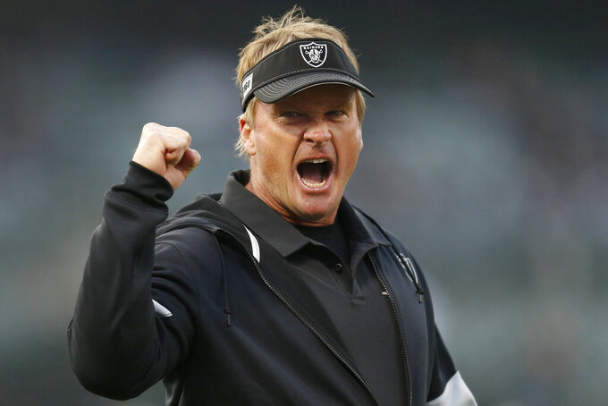 Oakland Raiders coach Jon Gruden gestures before the team's NFL football game against the Los Angeles Chargers in Oakland, Calif., Thursday, Nov. 7, 2019. (AP Photo/D. Ross Cameron)