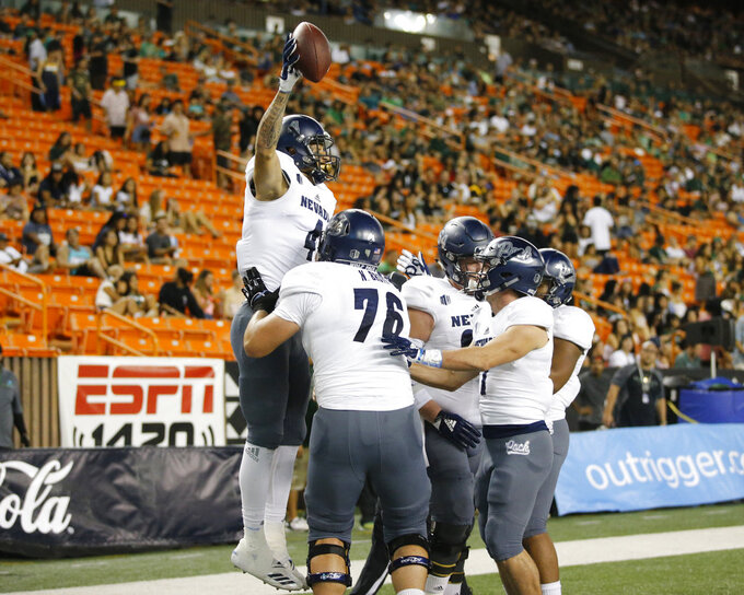 Nevada wide receiver Elijah Cooks (4) celebrates with teammates after making a touchdown against Hawaii during the first half of an NCAA college football game Saturday, Oct. 20, 2018, in Honolulu. (AP Photo/Marco Garcia)