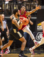 Indiana guard Armaan Franklin (2) defends against Purdue guard Jahaad Proctor, left, during the first half of an NCAA college basketball game Thursday, Feb. 27, 2020, in West Lafayette, Ind. (AP Photo/Doug McSchooler)