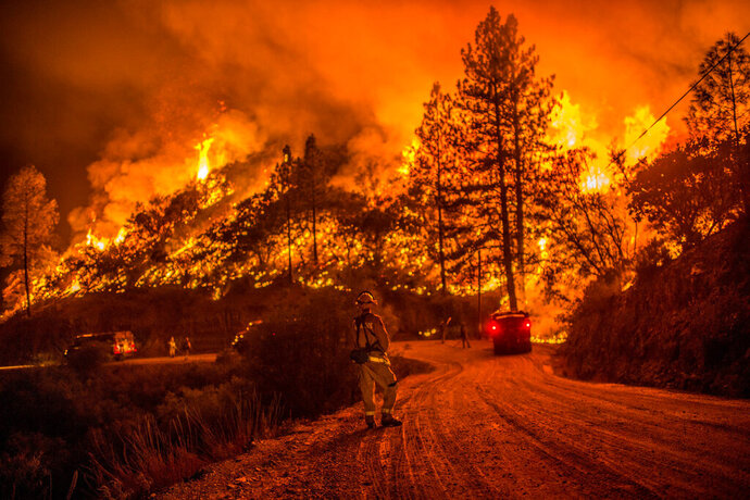 In this 2015 photo, fire crews run controlled burns at night to contain the Butte Fire near Arnold, Calif. In the community that serves as gateway to Calaveras Big Trees State Park, residents didn't always applaud when officials began mapping plans to thin dense stands of trees to reduce fire risk.