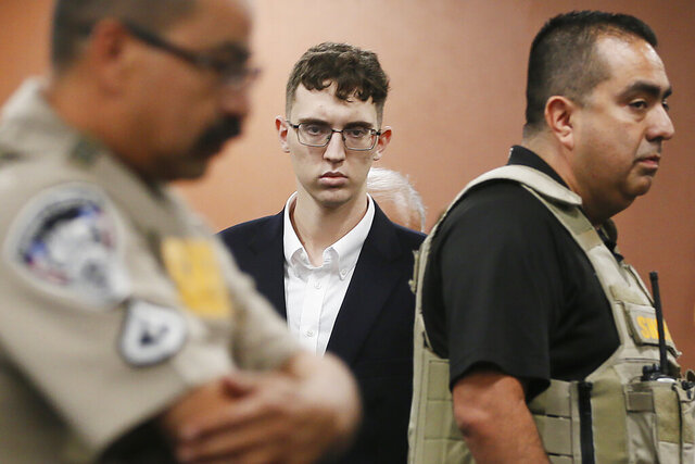 FILE - In the is Oct. 10, 2019 file photo, El Paso Walmart shooting suspect Patrick Crusius pleads not guilty during his arraignment in El Paso, Texas. Crusius, accused of killing 22 people at a Walmart Aug. 3, 2019 in Texas is expected to be reindicted Thursday, June 14, 2020 as he faces another murder charge in the mass shooting that targeted Mexicans, prosecutors said. (Briana Sanchez / El Paso Times via AP, Pool, File)