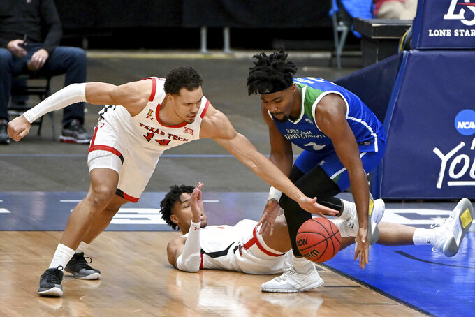 Texas Tech forward Marcus Santos-Silva (14) and Texas A&M-CC  guard Jalen White (3) go after a loose ball in the first half of an NCAA college basketball game in Frisco, Texas, Saturday, Dec. 12, 2020. (AP Photo/Matt Strasen)