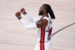 Miami Heat forward Jae Crowder (99) celebrates late in the second half of an NBA conference final playoff basketball game against the Boston Celtics on Thursday, Sept. 17, 2020, in Lake Buena Vista, Fla. (AP Photo/Mark J. Terrill)