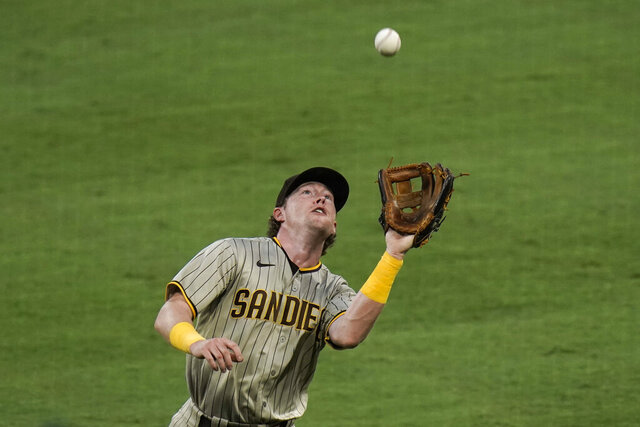San Diego Padres second baseman Jake Cronenworth catches a fly ball hit by Los Angeles Angels' Jo Adell during the second inning of a baseball game, Wednesday, Sept. 2, 2020, in Anaheim, Calif. (AP Photo/Jae C. Hong)