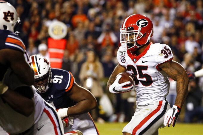 Georgia running back Brian Herrien (35) carries the ball against Auburn during the second half of an NCAA college football game, Saturday, Nov. 16, 2019, in Auburn, Ala. (AP Photo/Butch Dill)