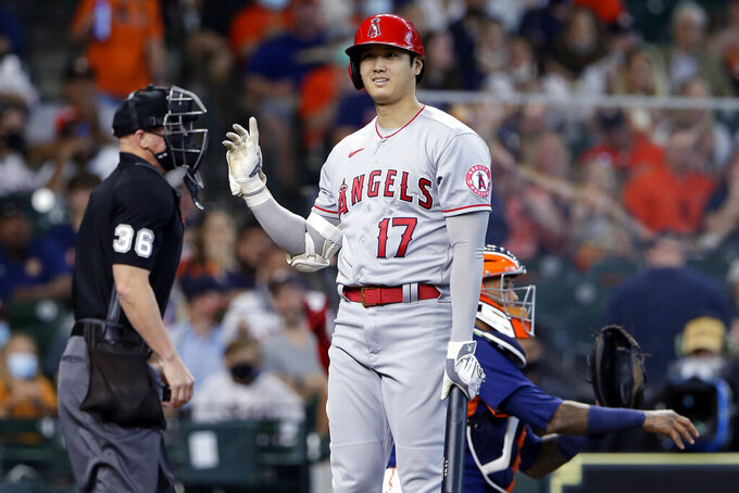 Los Angeles Angels designated hitter Shohei Ohtani (17) reacts to umpire Ryan Blakney (36) after getting called out on strikes as Houston Astros catcher Martin Maldonado, right, returns the ball during the first inning of a baseball game Sunday, April 25, 2021, in Houston. (AP Photo/Michael Wyke)
