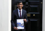 Britain's Chancellor of the Exchequer Rishi Sunak poses outside No 11 Downing Street, before heading for the House of Commons to give MPs details of his Winter Economy Plan, in London, Thursday Sept. 24, 2020. (AP Photo/Frank Augstein)