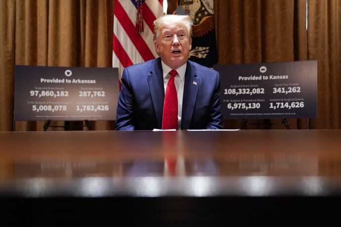 President Donald Trump speaks during a meeting with Arkansas Gov. Asa Hutchinson and Kansas Gov. Laura Kelly in the Cabinet Room of the White House, Wednesday, May 20, 2020, in Washington. (AP Photo/Evan Vucci)