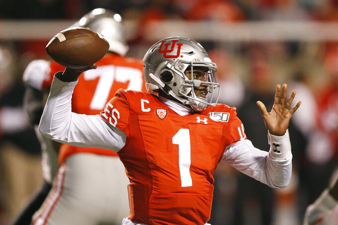 Utah quarterback Tyler Huntley (1) throws downfield in the first half during an NCAA college football game against Colorado Saturday, Nov. 30, 2019, in Salt Lake City. (AP Photo/Rick Bowmer)