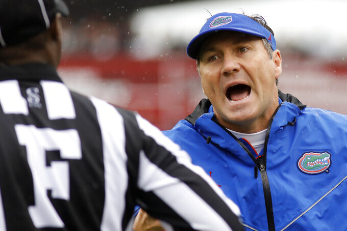 Florida's head coach Dan Mullen argues a call during the game against South Carolina in the first half of an NCAA college football game Saturday, Oct. 19, 2019, in Columbia, SC. (AP Photo/Mic Smith)