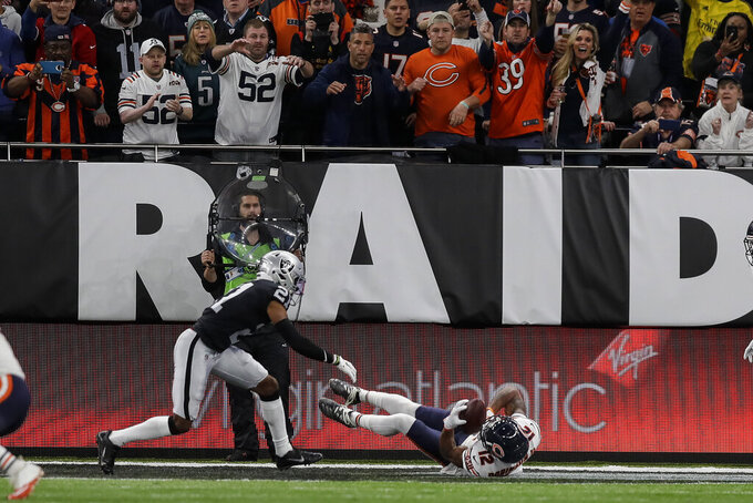 Chicago Bears wide receiver Allen Robinson (12) makes a touchdown reception against Oakland Raiders cornerback Gareon Conley (21) during the second half of an NFL football game at Tottenham Hotspur Stadium, Sunday, Oct. 6, 2019, in London. (AP Photo/Kirsty Wigglesworth)