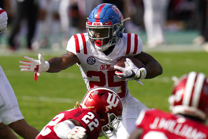 Mississippi running back Henry Parrish Jr. (25) eludes Indiana defensive back Jamar Johnson (22) on a rush during the first half of the Outback Bowl NCAA college football game Saturday, Jan. 2, 2021, in Tampa, Fla. (AP Photo/Chris O'Meara)