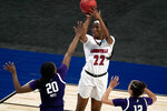 Louisville forward Elizabeth Dixon (22) shoots over Northwestern forward Paige Mott (20) during the first half of a college basketball game in the second round of the women's NCAA tournament at the Alamodome in San Antonio, Wednesday, March 24, 2021. (AP Photo/Charlie Riedel)