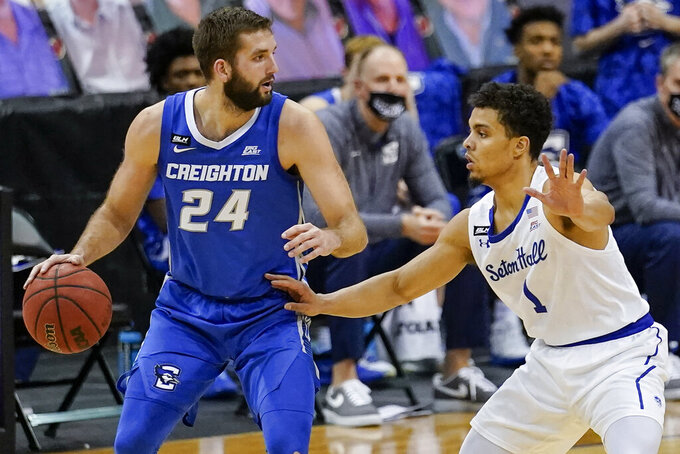 Seton Hall's Bryce Aiken (1) defends Creighton's Mitch Ballock (24) during the second half of an NCAA college basketball game Wednesday, Jan. 27, 2021, in Newark, N.J. Creighton won 85-81. (AP Photo/Frank Franklin II)