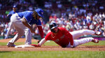 Boston Red Sox's Alex Verdugo, right, dives back safely, beating the tag by Toronto Blue Jays first baseman Vladimir Guerrero Jr., on a pick-off attempt in the second inning of a baseball game at Fenway Park, Wednesday, July 28, 2021, in Boston. (AP Photo/Charles Krupa)