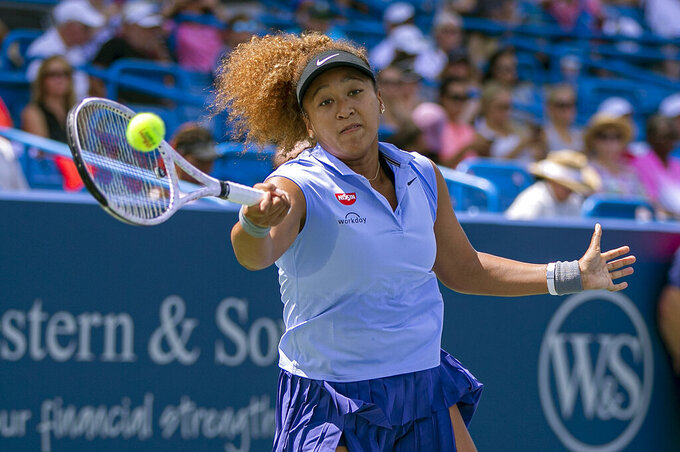 Naomi Osaka of Japan hits the ball to Cori Gauff of the United States during the Western & Southern Open tennis tournament at the Lindner Family Tennis Center, Wednesday, Aug. 18, 2021 in Mason, Ohio.(Cara Owsley/The Cincinnati Enquirer via AP)