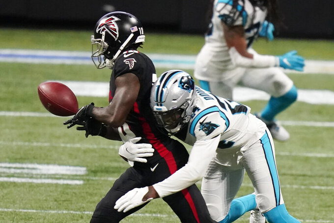 Atlanta Falcons wide receiver Calvin Ridley (18) misses the catch with Carolina Panthers cornerback Rasul Douglas (24) defending during the second half of an NFL football game, Sunday, Oct. 11, 2020, in Atlanta. (AP Photo/Brynn Anderson)