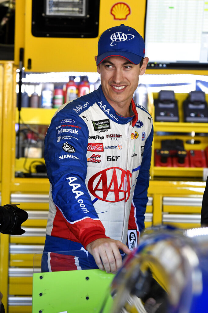 Joey Logano walks through the garage area during practice Friday, Nov. 1, 2019, for the NASCAR Cup Series auto race at Texas Motor Speedway in Forth Worth, Texas. (AP Photo/Larry Papke)