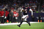 Houston Texans quarterback Tyrod Taylor (5) runs for a first down against the Tampa Bay Buccaneers during the first half of an NFL preseason football game Saturday, Aug. 28, 2021, in Houston. (AP Photo/Justin Rex)