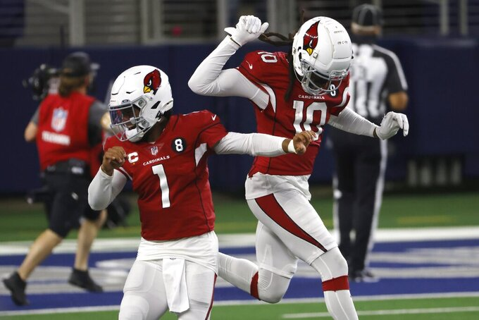 Arizona Cardinals' Kyler Murray (1) and DeAndre Hopkins (10) celebrate a touchdown scored by Christian Kirk (13) in the first half of an NFL football game against the Dallas Cowboys in Arlington, Texas, Monday, Oct. 19, 2020. (AP Photo/Ron Jenkins)