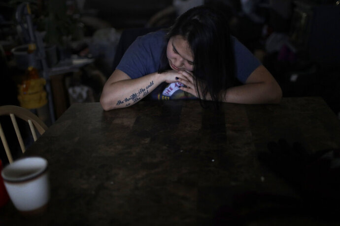 In this Feb. 16, 2019, photo, Deidre Levi rests her head for a moment in her grandmother's house before a basketball game in the Native Village of St. Michael, Alaska. Levi says she spoke up about being sexually assaulted because she wanted to be a role model for girls in Alaska. (AP Photo/Wong Maye-E)