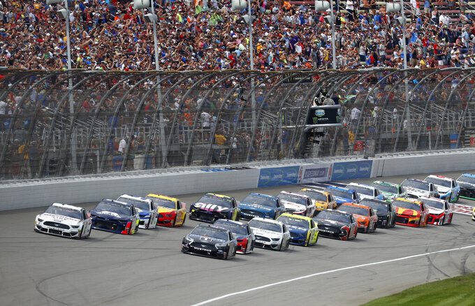 Cars start during a NASCAR Cup Series auto race at Michigan International Speedway in Brooklyn, Mich., Sunday, Aug. 11, 2019. (AP Photo/Paul Sancya)