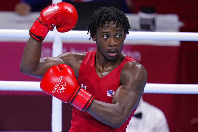 The United States' Keyshawn Davis celebrates after winning a men's lightweight 63-kg quarterfinal boxing match against Russian Olympic Committee's Gabil Mamedov at the 2020 Summer Olympics, Tuesday, Aug. 3, 2021, in Tokyo, Japan. (AP Photo/Frank Franklin II)