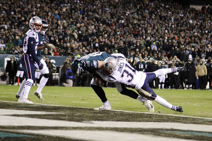 Philadelphia Eagles' Dallas Goedert (88) scores a touchdown against New England Patriots' Jonathan Jones (31) during the first half of an NFL football game, Sunday, Nov. 17, 2019, in Philadelphia. (AP Photo/Matt Rourke)