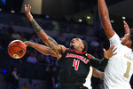 Louisville guard Khwan Fore (4) is stripped of the ball from behind by Georgia Tech guard Curtis Haywood II as forward James Banks III also defends during the first half of an NCAA college basketball game Saturday, Jan. 19, 2019 in Atlanta. (AP Photo/John Amis)