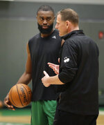Boston Celtics' Jaylen Brown, left, listens to assistant coach Jay Larranaga during the NBA basketball team's training camp, Tuesday, Oct. 1, 2019, in Boston. (AP Photo/Elise Amendola)