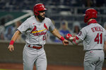 St. Louis Cardinals Matt Carpenter (13) is congratulated by teammate Tyler O'Neill (41) after his solo home run during the second inning of a baseball game in Kansas City, Mo., Monday, Sept. 21, 2020. (AP Photo/Orlin Wagner)