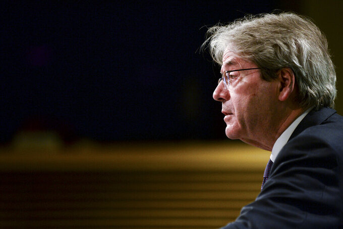 European Commissioner for Economy Paolo Gentiloni speaks during a media conference on the economic forecast for spring 2021 at EU headquarters in Brussels, Wednesday, May 12, 2021. The European Union economy is set to bounce back strongly this year after the deep coronavirus recession and member states are forecast to have recouped the ground lost by the end of next year. (Johanna Geron, Pool via AP)