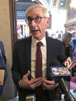 FILE--In this Tuesday, April 9, 2019, file photo, Wisconsin Democratic Gov. Tony Evers talks to reporters during a lame-duck legislative session in Madison, Wisconsin. Flying a gay pride rainbow flag over the Wisconsin state Capitol for the first time is drawing backlash from a conservative Republican lawmaker who said it was divisive. The flag flap Friday erupted after Evers ordered the raising of the flag to recognize June as