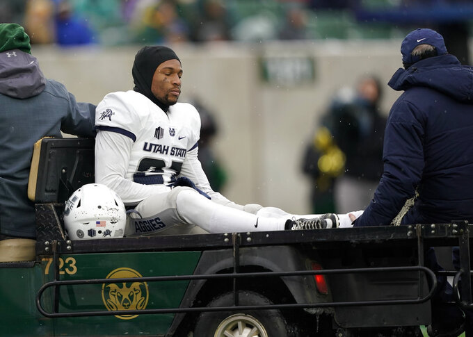 Utah State cornerback Deante Fortenberry (27) is carted off the field after an injury in the first half of an NCAA football game against Colorado State, Saturday, Nov. 17, 2018, in Fort Collins, Colo. (AP Photo/Jack Dempsey)