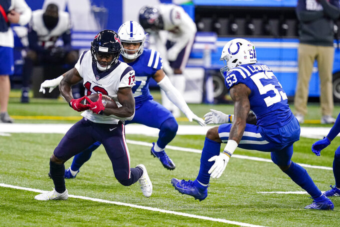 Houston Texans wide receiver Brandin Cooks (13) is tackled by Indianapolis Colts outside linebacker Darius Leonard (53) in the first half of an NFL football game in Indianapolis, Sunday, Dec. 20, 2020. (AP Photo/Darron Cummings)
