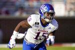 FILE - In this Nov. 7, 2020, file photo, Kansas linebacker Kyron Johnson (15) follows a play during an NCAA college football game against Oklahoma in Norman, Okla. (AP Photo/Sue Ogrocki, File)