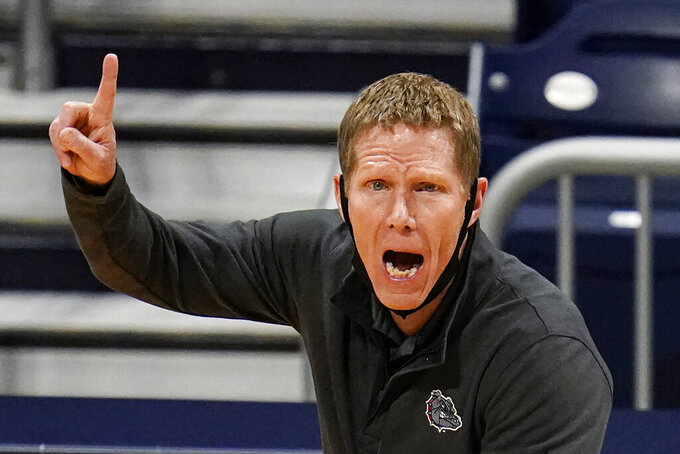 FILE - Gonzaga head coach Mark Few calls a play for his team as they play against Oklahoma in the first half of a second-round game in the NCAA men's college basketball tournament at Hinkle Fieldhouse in Indianapolis, in this Monday, March 22, 2021, file photo. Gonzaga carried a No. 1 ranking all last season before falling a win short of becoming college basketball's first unbeaten national champion in 45 years. Mark Few's Bulldogs start this season in the same position, hoping to complete that final step this time around. The Zags were the runaway top choice in The Associated Press Top 25 men's college basketball preseason poll released Monday, Oct. 18, 2021. (AP Photo/Michael Conroy, File)