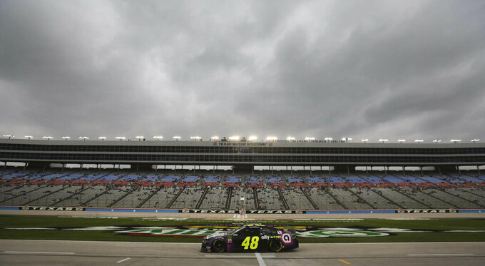 Jimmie Johnson (48) drives on pit row during qualifying for the NASCAR Cup Series auto race at Texas Motor Speedway in Fort Worth, Texas, Friday, March 29, 2019. (AP Photo/LM Otero)