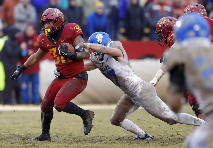 Iowa State running back David Montgomery tries to break a tackle by Drake linebacker Connor Willis, right, during the first half of an NCAA college football game, Saturday, Dec. 1, 2018, in Ames, Iowa. (AP Photo/Charlie Neibergall)