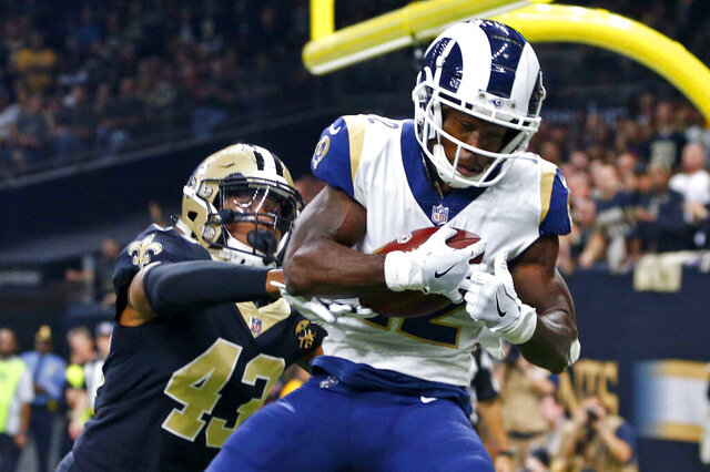 FILE - In this Nov. 4, 2018, file photo, Los Angeles Rams wide receiver Brandin Cooks (12) pulls in a touchdown reception in front of New Orleans Saints free safety Marcus Williams (43) in the first half of an NFL football game in New Orleans. A person familiar with the deal says the Rams are trading Cooks to the Houston Texans. The person spoke on condition of anonymity Thursday, April 9, 2020, because the teams had not announced the deal. The NFL Network reported the Rams will get a second-round pick while sending a future fourth-rounder to Houston. (AP Photo/Butch Dill, File)