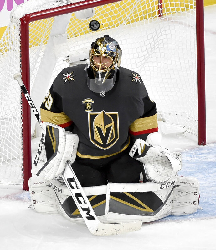 Vegas Golden Knights goaltender Marc-Andre Fleury makes a save against the Winnipeg Jets during the second period of Game 3 of the NHL hockey playoffs Western Conference finals Wednesday, May 16, 2018, in Las Vegas. (AP Photo/David Becker)