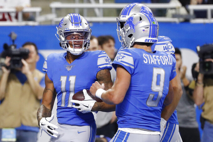 Detroit Lions wide receiver Marvin Jones (11) is greeted by quarterback Matthew Stafford (9) after a 10-yard reception for a touchdown during the first half of an NFL football game against the Minnesota Vikings, Sunday, Oct. 20, 2019, in Detroit. (AP Photo/Rick Osentoski)