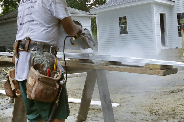 FILE - In this Oct. 2, 2019, file photo, a carpenter works on a construction site in North Andover, Mass. On Friday, Jan. 17, 2020, the Commerce Department reports on U.S. home construction in December. (AP Photo/Elise Amendola, File)
