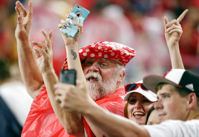 Fans at Memorial Stadium dance to music played during a lightning delay in the first half of an NCAA college football game between Nebraska and Akron in Lincoln, Neb., Saturday, Sept. 1, 2018. (AP Photo/Nati Harnik)