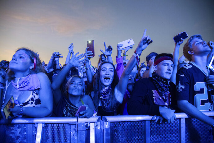 FILE - In this Sunday, Oct. 27, 2019, file photo, festival-goers attend the Voodoo Music Experience in City Park in New Orleans. Major concert promoters in the U.S. are stepping back from plans to scan festival-goers with facial recognition technology, at least for the time being. Voodoo Music confirmed that they don't use facial recognition technology. (Photo by Amy Harris/Invision/AP, File)