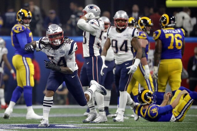 New England Patriots' Dont'a Hightower (54) celebrates after he sacked Los Angeles Rams' Jared Goff, down on the turf at right, during the second half of the NFL Super Bowl 53 football game Sunday, Feb. 3, 2019, in Atlanta. (AP Photo/Chuck Burton)