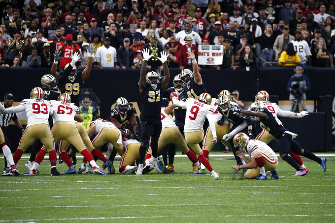 San Francisco 49ers kicker Robbie Gould (9) kicks the game winning field goal at the end of regulation in the second half an NFL football game against the New Orleans Saints in New Orleans, Sunday, Dec. 8, 2019. The 49ers won 48-46. (AP Photo/Butch Dill)