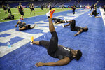 Louisville offensive lineman Mekhi Becton stretches at the NFL football scouting combine in Indianapolis, Friday, Feb. 28, 2020. (AP Photo/Charlie Neibergall)
